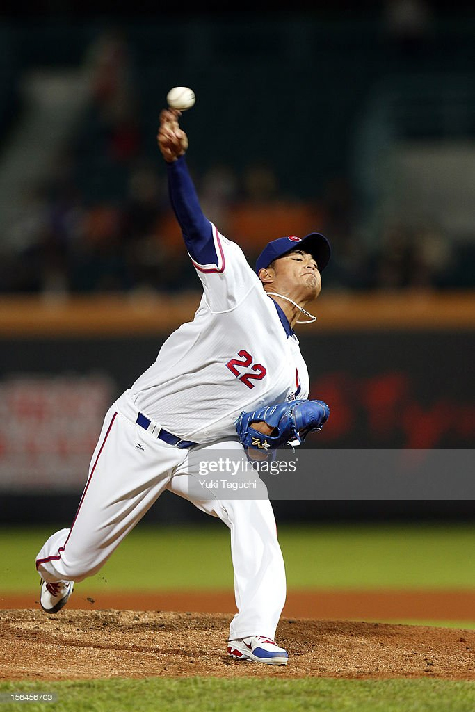 Yao-Lin Wang #22 of Team Chinese Taipei pitches during Game 2 of the 2013 World Baseball Classic Qualifier against Team New Zealand at Xinzhuang Stadium in New Taipei City, Taiwan on Thursday, November 15, 2012.