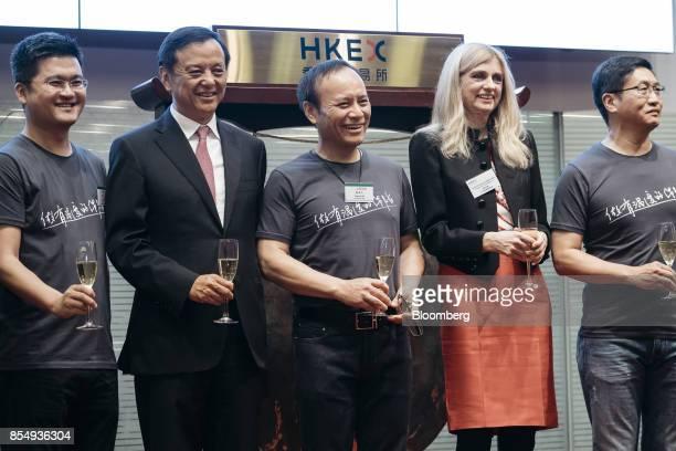 Yaping Ou chairman of ZhongAn Online PC Insurance Co center Jeffrey Chen chief executive officer right and Charles Li chief executive officer of Hong...