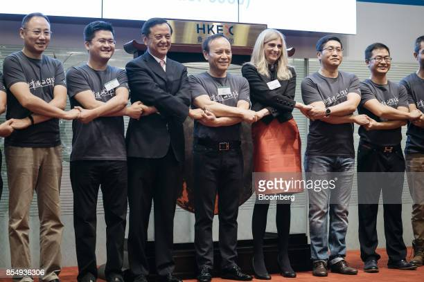 Yaping Ou chairman of ZhongAn Online PC Insurance Co center Jeffrey Chen chief executive officer third right and Charles Li chief executive officer...