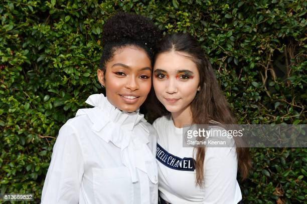 Yara Shahidi and Rowan Blanchard wear Chanel at CHANEL Dinner Celebrating Lucia Pica The Travel Diary Makeup Collection on July 12 2017 in Los...