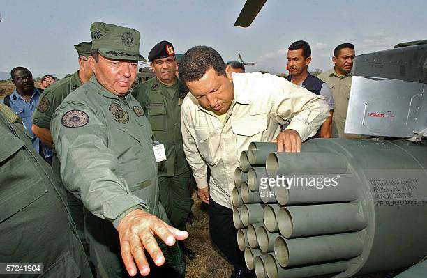 Venezuela's President Hugo Chavez accompanied by lieutenant colonel Pedro Acosta Rodriguez inspects 03 April 2006 in Yaracuy 200 km south east of...