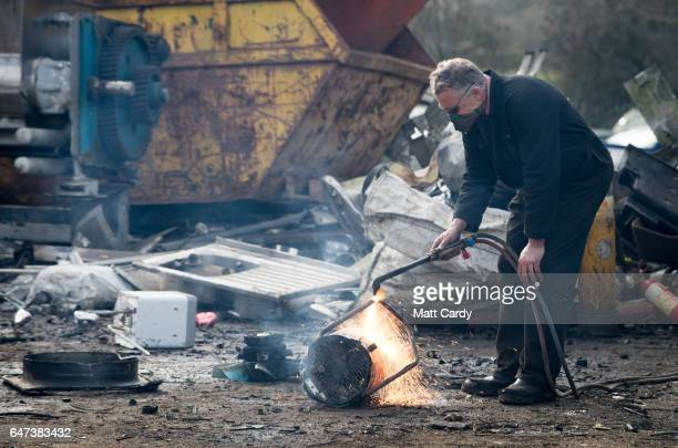 Yard owner Ped Rossiter cuts up scrap at Pylle Motor Spares and Metal Processing a licensed scrap yard in Pylle near Shepton Mallet on March 2 2017...