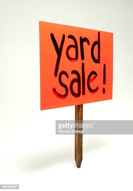Yard sale sign on a wooden stake