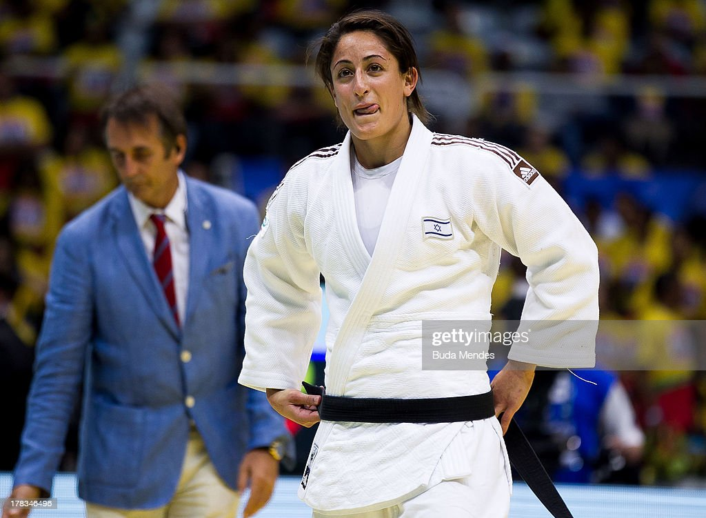 Yarden Gerbi (white) of Israel celebrates the victory and a gold medal in the final -63 kg category during the World Judo Championships at Gymnasium Maracanazinho on August 29, 2013 in Rio de Janeiro, Brazil.