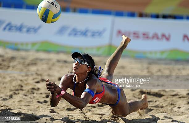 Yarleen Santiago of Puerto Rico dives for the ball during the women's beach volleyball match against Argentina at the XVI Pan American Games in...