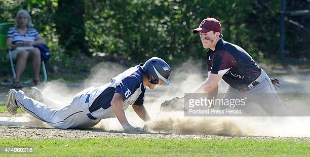 Yarmouth Cody Cook gets caught sliding into third base by Freeport third baseman Freeport Nate Cyr as Freeport hosts Yarmouth in high school baseball...