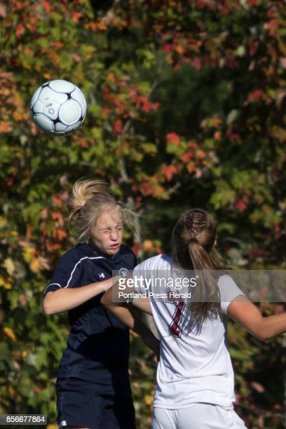 Yarmouth's Lily Davis heads the ball as Freeport's Allie Goodman challenges her during the girls' soccer game in Freeport on Friday September 29 2017