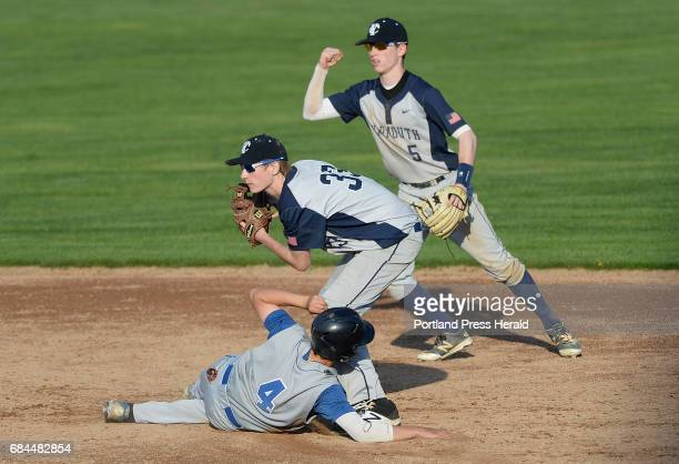 Yarmouth's Toby Burgmaier watches for the call after tagging out Joey McCullum of Old Orchard Beach as Yarmouth's Chris Romano celebrates in the...