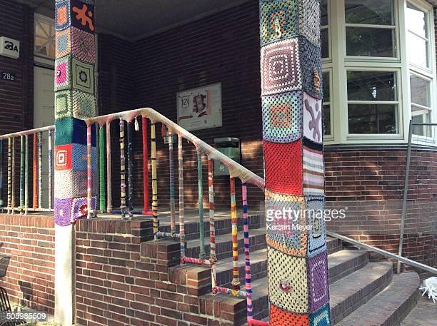 Yarn bombed hand rail and pillars