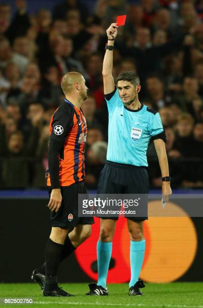 Yaroslav Rakitskiy of Shakhtar Donetsk is shown a red card by referee Alberto Undiano Mallenco during the UEFA Champions League group F match between...