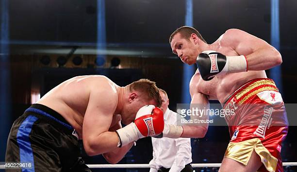 Yaroslav Zavorotnyi of Ukraine and David Price of Great Britain exchange punches during their heavyweight fight at Sport und Kongresshalle on June 7...