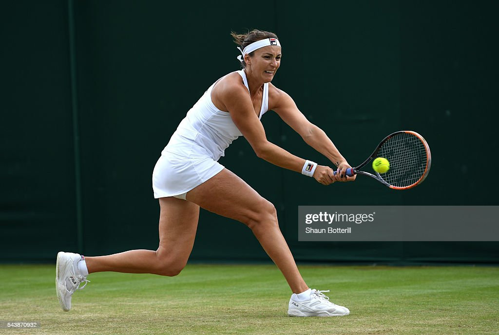 <a gi-track='captionPersonalityLinkClicked' href=/galleries/search?phrase=Yaroslava+Shvedova&family=editorial&specificpeople=5407439 ng-click='$event.stopPropagation()'>Yaroslava Shvedova</a> of Kazakhstan plays a backhand during the Ladies Singles second round match against Elina Svitolina of Ukraine on day four of the Wimbledon Lawn Tennis Championships at the All England Lawn Tennis and Croquet Club on June 30, 2016 in London, England.