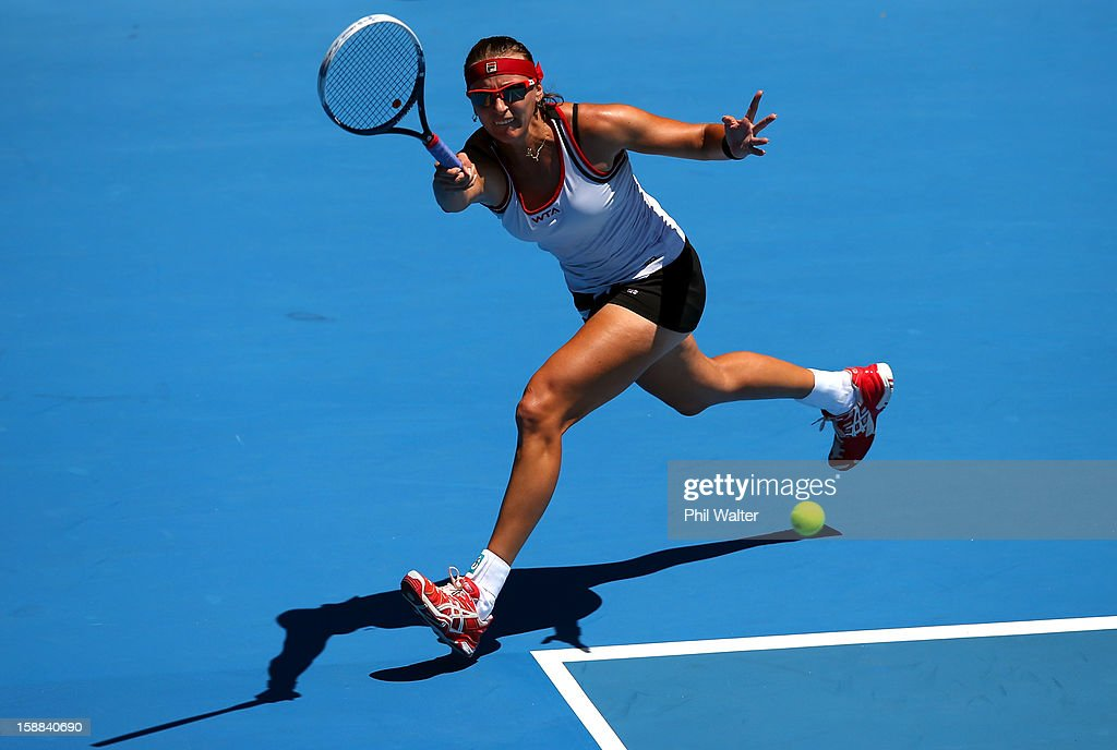 <a gi-track='captionPersonalityLinkClicked' href=/galleries/search?phrase=Yaroslava+Shvedova&family=editorial&specificpeople=5407439 ng-click='$event.stopPropagation()'>Yaroslava Shvedova</a> of Kazakhstan plays a forehand in her first round match against Lara Arruabarrena-Vecino of Spain during day two of the 2013 ASB Classic on January 1, 2013 in Auckland, New Zealand.