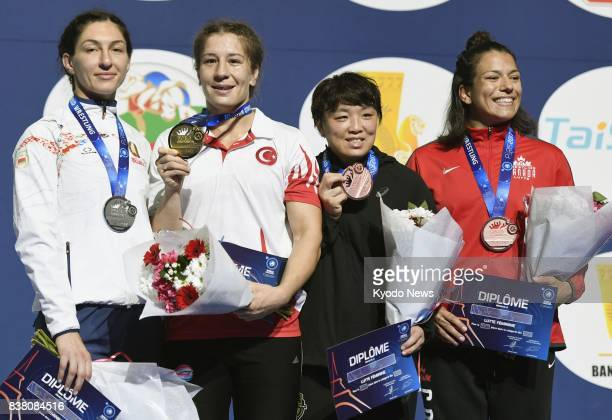 Yasemin Adar of Turkey poses after winning the women's 75 kilogramclass gold medal at the world wrestling championships in Paris on Aug 23 2017...