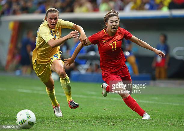 Yasha Gu of China PR and Jessica Samuelsson of Sweden challenge for the ball during the Women's First Round Group E match between China PR and Sweden...