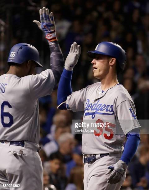 Yasiel Puig and Cody Bellinger of the Los Angeles Dodgers celebrate after Bellinger hit a home run in the third inning against the Chicago Cubs...