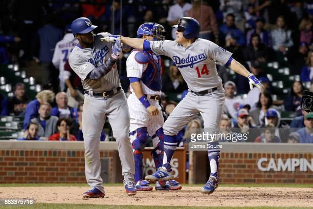 Yasiel Puig and Enrique Hernandez of the Los Angeles Dodgers celebrate after Hernandez hit a home run in the ninth inning against the Chicago Cubs...