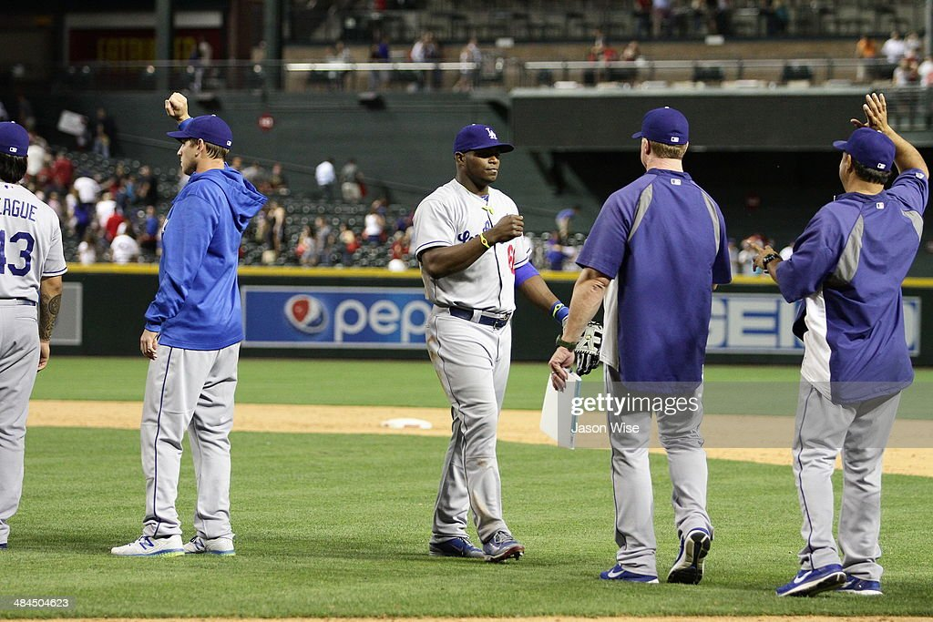<a gi-track='captionPersonalityLinkClicked' href=/galleries/search?phrase=Yasiel+Puig&family=editorial&specificpeople=10484087 ng-click='$event.stopPropagation()'>Yasiel Puig</a> #66 and <a gi-track='captionPersonalityLinkClicked' href=/galleries/search?phrase=Mark+McGwire&family=editorial&specificpeople=202109 ng-click='$event.stopPropagation()'>Mark McGwire</a> #25 of the Los Angeles Dodgers celebrate their 8-5 victory over the Diamondbacks at Chase Field on April 12, 2014 in Phoenix, Arizona.