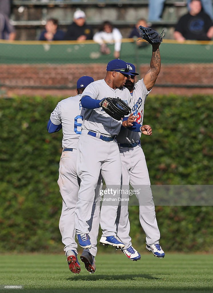 Yasiel Puig #66, Carl Crawford #3 and Matt Kemp #27 of the Los Angeles Dodgers celebrate a win over the Chicago Cubs at Wrigley Field on September 21, 2014 in Chicago, Illinois. The Dodgers defeated the Cubs 8-5.