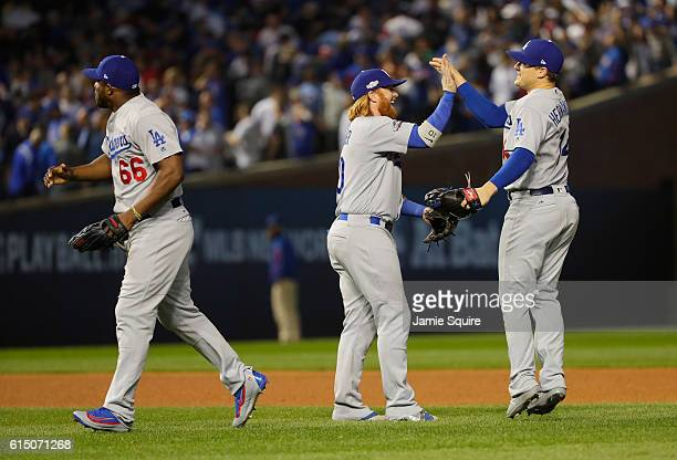 Yasiel Puig Justin Turner and Enrique Hernandez of the Los Angeles Dodgers celebrate after defeating the Chicago Cubs 10 in game two of the National...