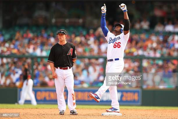 Yasiel Puig of the Dodgers gestures to the sky after hitting a base double during the MLB match between the Los Angeles Dodgers and the Arizona...