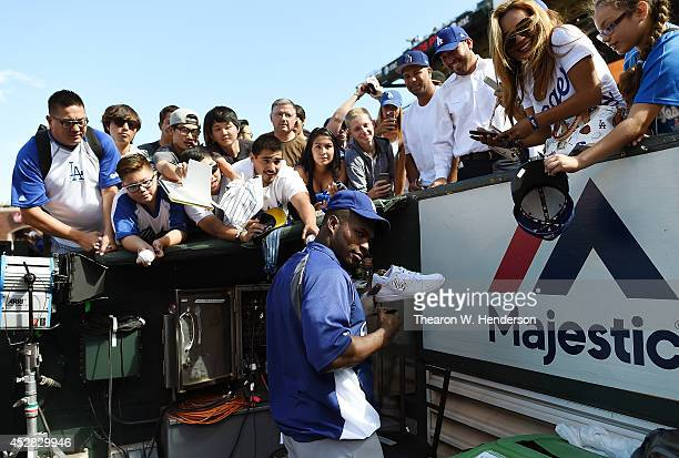 Yasiel Puig of the Los Angeles Dodgeres signs autographs for fans prior to the game against the San Francisco Giants at ATT Park on July 27 2014 in...