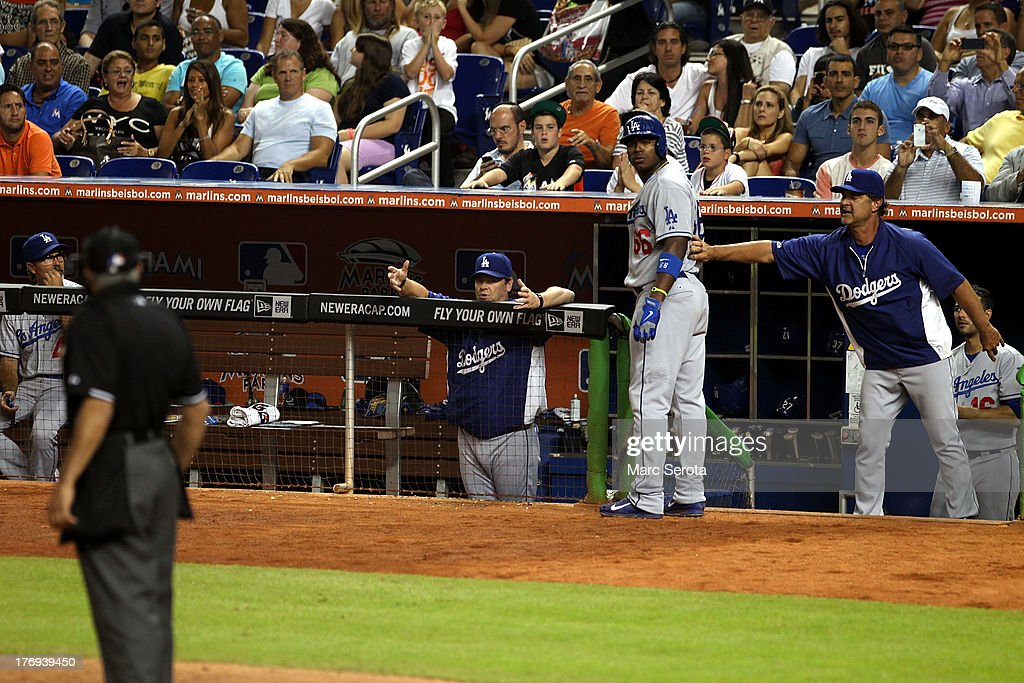 <a gi-track='captionPersonalityLinkClicked' href=/galleries/search?phrase=Yasiel+Puig&family=editorial&specificpeople=10484087 ng-click='$event.stopPropagation()'>Yasiel Puig</a> #66 of the Los Angeles Dodgers (2-R) arhues with the umpire after striking out in the fifth inning against the Miami Marlins at Marlins Park on August 19, 2013 in Miami, Florida.