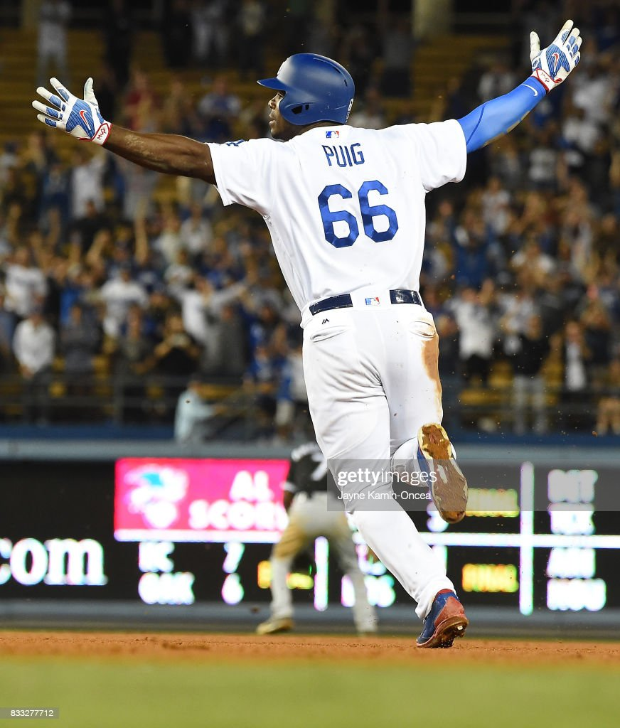 Yasiel Puig #66 of the Los Angeles Dodgers celebrates a walk off three run home run to defeat the Chicago White Sox in the ninth inning of the game at Dodger Stadium on August 16, 2017 in Los Angeles, California.