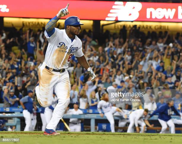 Yasiel Puig of the Los Angeles Dodgers celebrates a walk off three run home run to defeat the Chicago White Sox in the ninth inning of the game at...