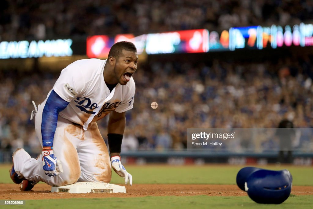 Yasiel Puig #66 of the Los Angeles Dodgers celebrates after hitting a triple in the seventh inning against the Arizona Diamondbacks in game one of the National League Division Series at Dodger Stadium on October 6, 2017 in Los Angeles, California.