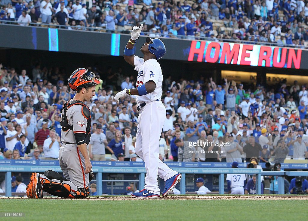 <a gi-track='captionPersonalityLinkClicked' href=/galleries/search?phrase=Yasiel+Puig&family=editorial&specificpeople=10484087 ng-click='$event.stopPropagation()'>Yasiel Puig</a> #66 of the Los Angeles Dodgers celebrates at home play after hitting a solo home run in the first inning as catcher <a gi-track='captionPersonalityLinkClicked' href=/galleries/search?phrase=Buster+Posey&family=editorial&specificpeople=4896435 ng-click='$event.stopPropagation()'>Buster Posey</a> #28 of the San Francisco Giants looks on during the MLB game at Dodger Stadium on June 24, 2013 in Los Angeles, California. The Dodgers defeated the Giants 3-1.