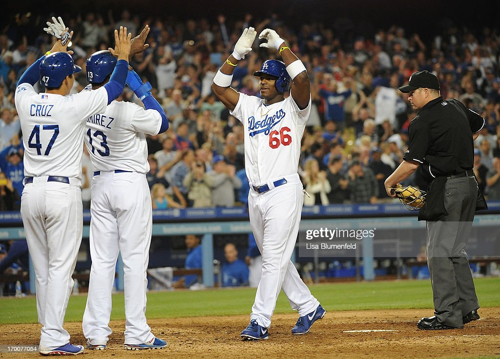 <a gi-track='captionPersonalityLinkClicked' href=/galleries/search?phrase=Yasiel+Puig&family=editorial&specificpeople=10484087 ng-click='$event.stopPropagation()'>Yasiel Puig</a> #66 of the Los Angeles Dodgers celebrates at homeplate after hitting a grandslam homerun in the eighth inning against the Atlanta Braves at Dodger Stadium on June 6, 2013 in Los Angeles, California.