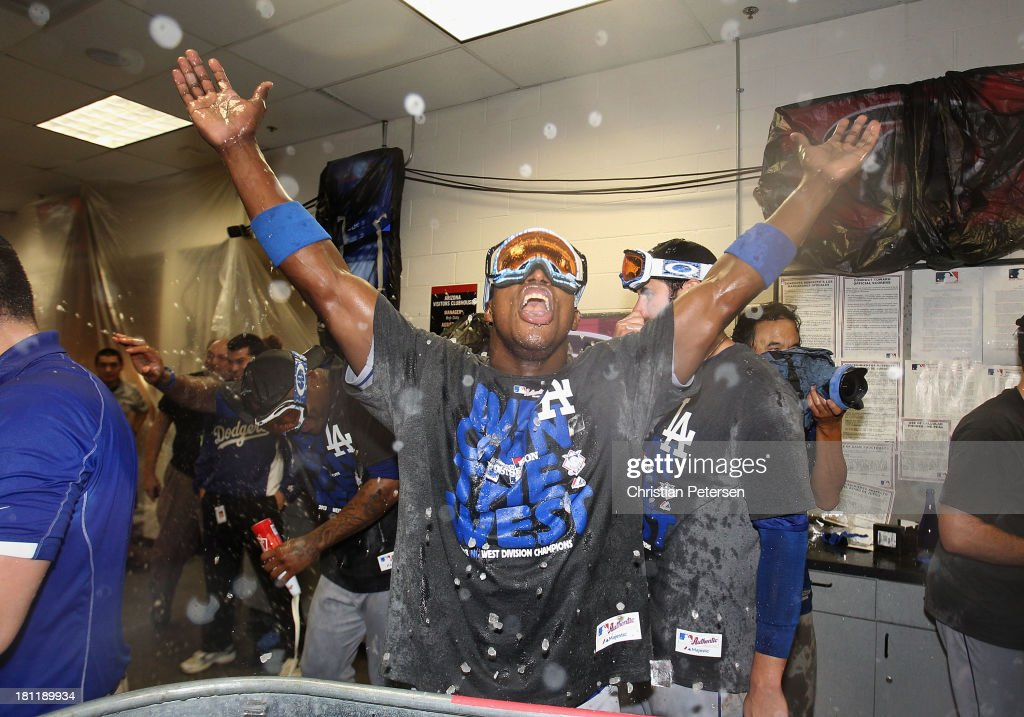 <a gi-track='captionPersonalityLinkClicked' href=/galleries/search?phrase=Yasiel+Puig&family=editorial&specificpeople=10484087 ng-click='$event.stopPropagation()'>Yasiel Puig</a> #66 of the Los Angeles Dodgers celebrates in the locker room after defeating the Arizona Diamondbacks to clinch the National League West title and a postseason berth at Chase Field on September 19, 2013 in Phoenix, Arizona.
