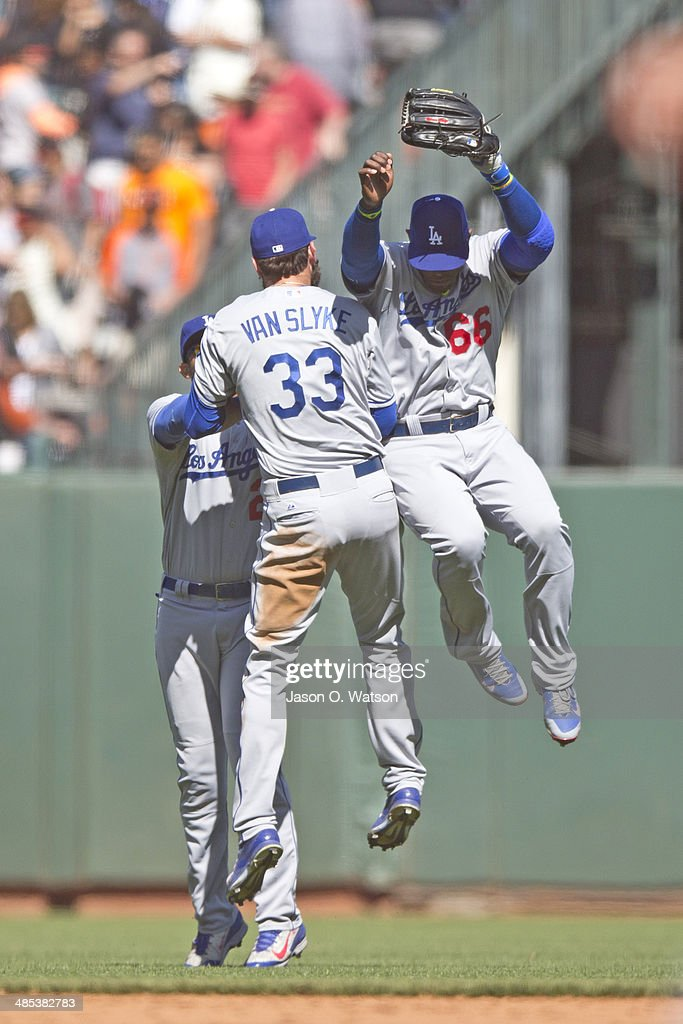 <a gi-track='captionPersonalityLinkClicked' href=/galleries/search?phrase=Yasiel+Puig&family=editorial&specificpeople=10484087 ng-click='$event.stopPropagation()'>Yasiel Puig</a> #66 of the Los Angeles Dodgers celebrates with <a gi-track='captionPersonalityLinkClicked' href=/galleries/search?phrase=Scott+Van+Slyke&family=editorial&specificpeople=9008639 ng-click='$event.stopPropagation()'>Scott Van Slyke</a> #33 and <a gi-track='captionPersonalityLinkClicked' href=/galleries/search?phrase=Matt+Kemp&family=editorial&specificpeople=567161 ng-click='$event.stopPropagation()'>Matt Kemp</a> #27 in the outfield after the game against the San Francisco Giants at AT&T Park on April 17, 2014 in San Francisco, California. The Los Angeles Dodgers defeated the San Francisco Giants 2-1.