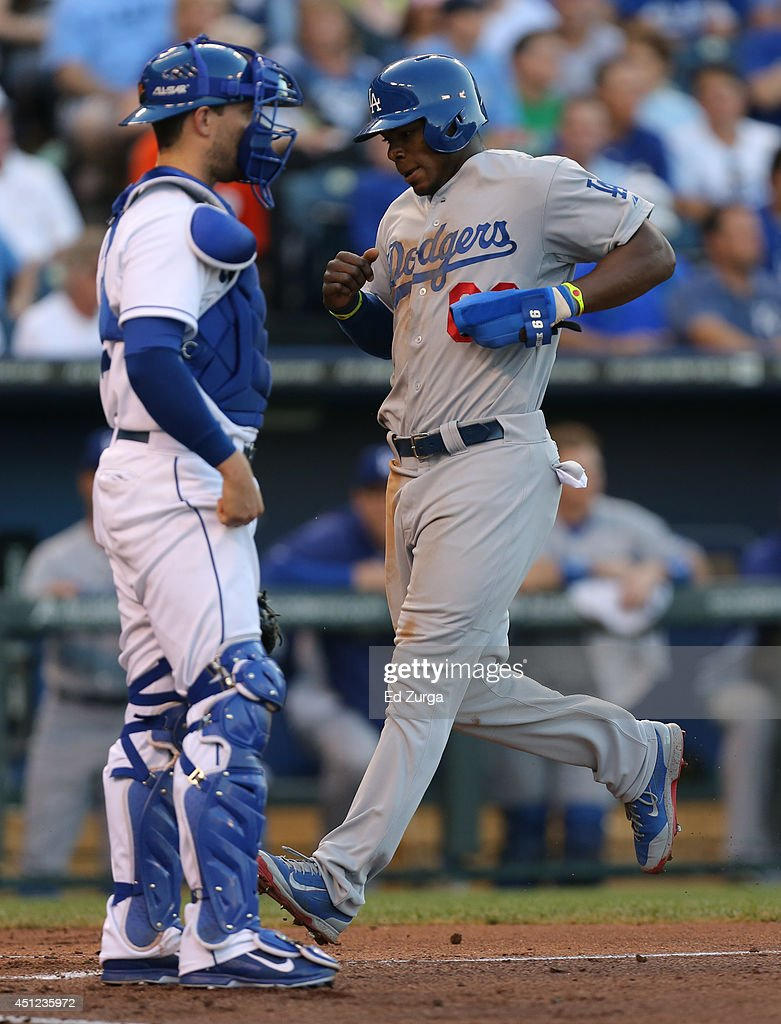 <a gi-track='captionPersonalityLinkClicked' href=/galleries/search?phrase=Yasiel+Puig&family=editorial&specificpeople=10484087 ng-click='$event.stopPropagation()'>Yasiel Puig</a> #66 of the Los Angeles Dodgers crosses home plate past <a gi-track='captionPersonalityLinkClicked' href=/galleries/search?phrase=Brett+Hayes&family=editorial&specificpeople=795648 ng-click='$event.stopPropagation()'>Brett Hayes</a> #12 of the Kansas City Royalsas he scores on an Adrian Gonzalez sacrifice fly in the third inning at Kauffman Stadium on June 25, 2014 in Kansas City, Missouri.