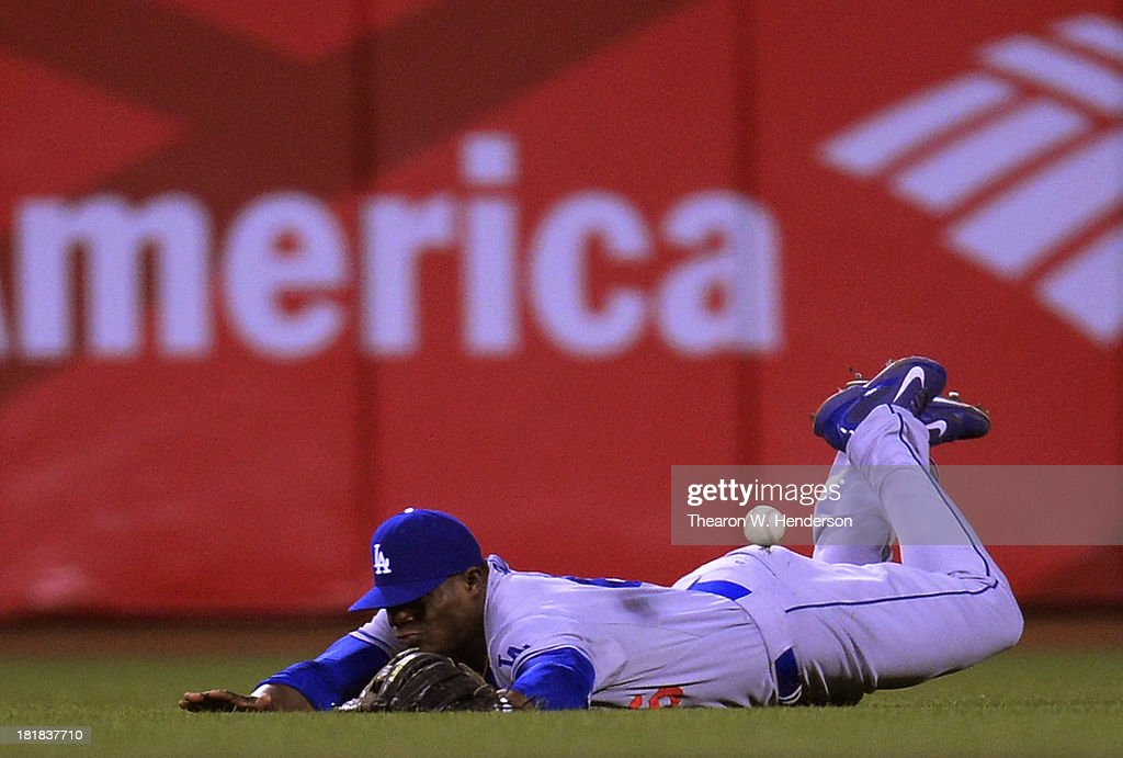 <a gi-track='captionPersonalityLinkClicked' href=/galleries/search?phrase=Yasiel+Puig&family=editorial&specificpeople=10484087 ng-click='$event.stopPropagation()'>Yasiel Puig</a> #66 of the Los Angeles Dodgers dives but can't make the catch of this ball that goes for an rbi double off the bat of Tony Abreu #10 of the San Francisco Giants (not pictured) during the six inning at AT&T Park on September 25, 2013 in San Francisco, California.