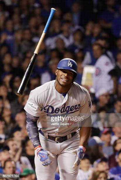 Yasiel Puig of the Los Angeles Dodgers flips his bat after popping out in the third inning against the Chicago Cubs during game four of the National...