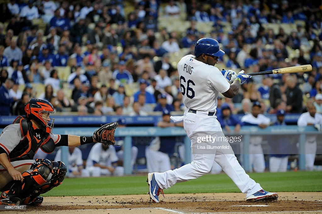 <a gi-track='captionPersonalityLinkClicked' href=/galleries/search?phrase=Yasiel+Puig&family=editorial&specificpeople=10484087 ng-click='$event.stopPropagation()'>Yasiel Puig</a> #66 of the Los Angeles Dodgers flys out to center field in the first inning against the San Francisco Giants at Dodger Stadium on May 9, 2014 in Los Angeles, California.