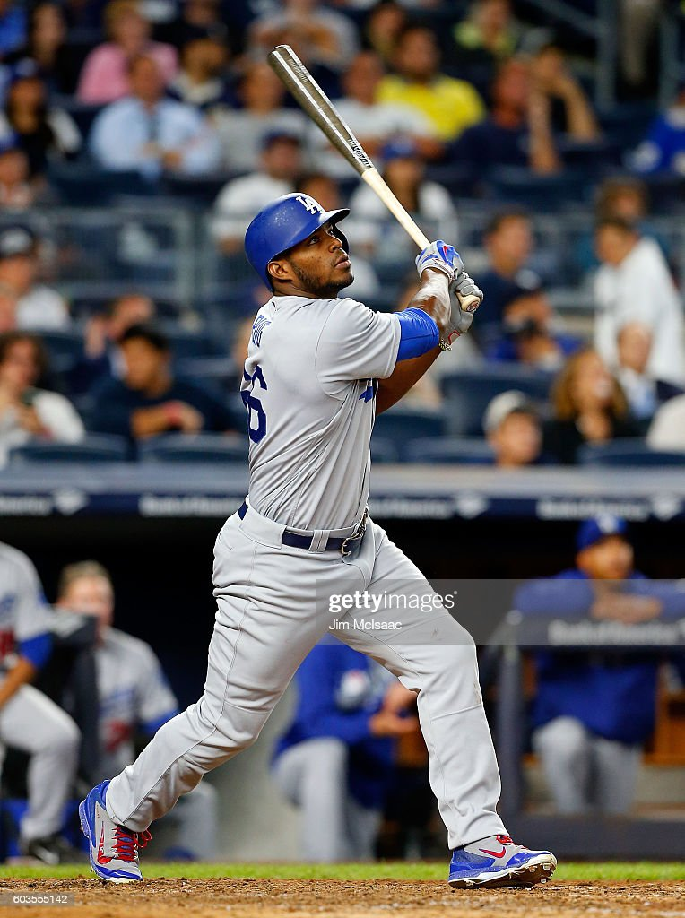 Yasiel Puig #66 of the Los Angeles Dodgers follows through on an eighth inning home run against the New York Yankees at Yankee Stadium on September 12, 2016 in the Bronx borough of New York City.