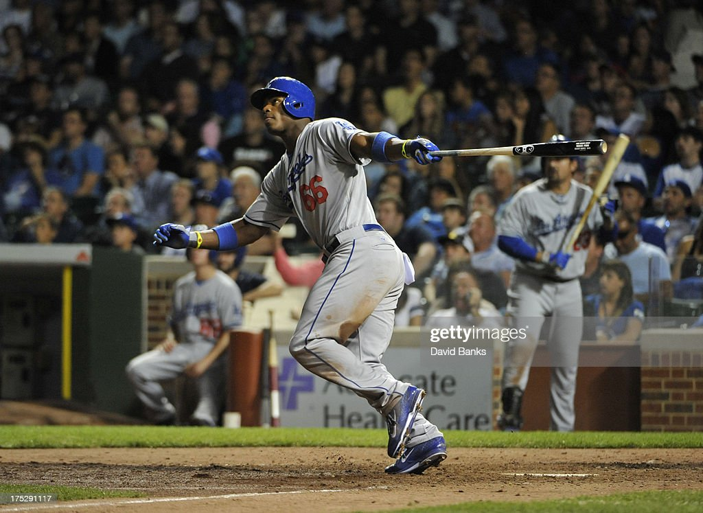 <a gi-track='captionPersonalityLinkClicked' href=/galleries/search?phrase=Yasiel+Puig&family=editorial&specificpeople=10484087 ng-click='$event.stopPropagation()'>Yasiel Puig</a> #66 of the Los Angeles Dodgers hits a home run against the Chicago Cubsduring the ninth inning on August 1, 2013 at Wrigley Field in Chicago, Illinois.