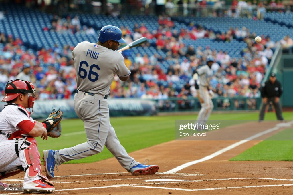 Yasiel Puig #66 of the Los Angeles Dodgers hits a one run single in the first inning against the Philadelphia Phillies at Citizens Bank Park on May 23, 2014 in Philadelphia, Pennsylvania.