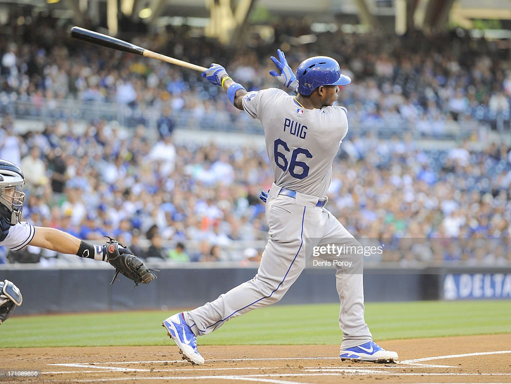 <a gi-track='captionPersonalityLinkClicked' href=/galleries/search?phrase=Yasiel+Puig&family=editorial&specificpeople=10484087 ng-click='$event.stopPropagation()'>Yasiel Puig</a> #66 of the Los Angeles Dodgers hits a single during the first inning of a baseball game against the San Diego Padres at Petco Park on June 21, 2013 in San Diego, California.