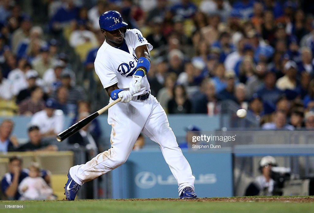 <a gi-track='captionPersonalityLinkClicked' href=/galleries/search?phrase=Yasiel+Puig&family=editorial&specificpeople=10484087 ng-click='$event.stopPropagation()'>Yasiel Puig</a> #66 of the Los Angeles Dodgers hits a single in the sixth inning against the New York Mets at Dodger Stadium on August 13, 2013 in Los Angeles, California.