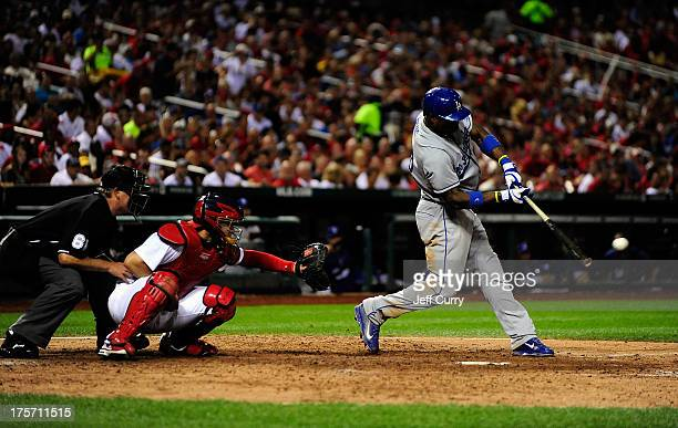 Yasiel Puig of the Los Angeles Dodgers hits a single off of Joe Kelly of the St Louis Cardinals during the sixth inning at Busch Stadium on August 6...