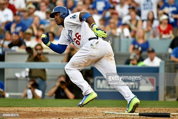 Yasiel Puig of the Los Angeles Dodgers hits a single to score teammate AJ Ellis in the fourth inning against the St Louis Cardinals during Game One...