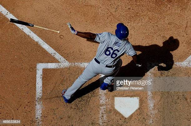 Yasiel Puig of the Los Angeles Dodgers hits a solo home run against the Arizona Diamondbacks during the fifth inning of the MLB game at Chase Field...