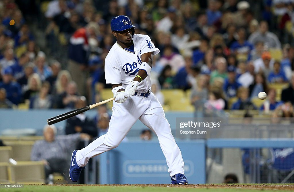 <a gi-track='captionPersonalityLinkClicked' href=/galleries/search?phrase=Yasiel+Puig&family=editorial&specificpeople=10484087 ng-click='$event.stopPropagation()'>Yasiel Puig</a> #66 of the Los Angeles Dodgers hits a solo home run in the sixth inning against the Atlanta Braves at Dodger Stadium on June 7, 2013 in Los Angeles, California.