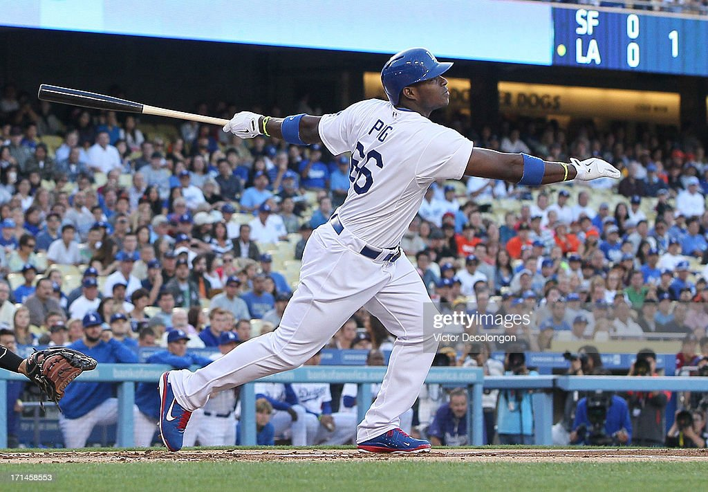 <a gi-track='captionPersonalityLinkClicked' href=/galleries/search?phrase=Yasiel+Puig&family=editorial&specificpeople=10484087 ng-click='$event.stopPropagation()'>Yasiel Puig</a> #66 of the Los Angeles Dodgers hits a solo home run in the first inning during the MLB game against the San Francisco Giants at Dodger Stadium on June 24, 2013 in Los Angeles, California.