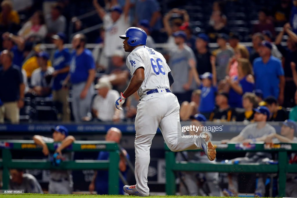 Yasiel Puig #66 of the Los Angeles Dodgers hits a solo home run in the twelfth inning against the Pittsburgh Pirates at PNC Park on August 21, 2017 in Pittsburgh, Pennsylvania.