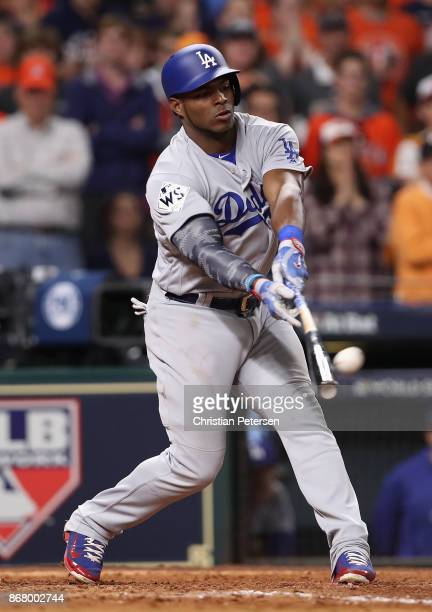 Yasiel Puig of the Los Angeles Dodgers hits a tworun home run during the ninth inning against the Houston Astros in game five of the 2017 World...